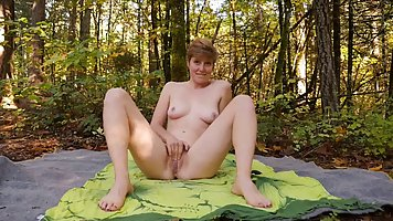 Lovely amateur lady is doing yoga in the nature and gently rubbing her wet pussy