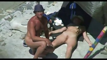 Naked people are fucking like wild animals, on the beach, in the middle of the day