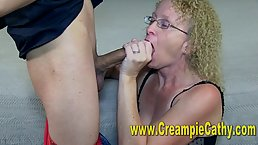 Mature woman with blonde, curly hair is sucking dick and getting fucked in a hotel room