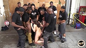 Dirty minded brunette is having group sex with many handsome black guys from her neighborhood