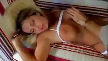 Drunk slut is lying on the bed, while her friend is fucking her wet pussy