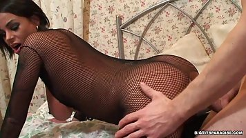 Seductive brunette in a finshent bodysuit is getting fucked and moaning from pleasure while cumming