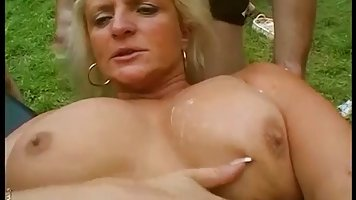 Blindfolded milf is lying and waiting to get sticky sperm all over her body, while in the garden
