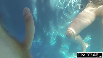 Naughty blonde chick is having sex in the swimming pool, in the middle of the day
