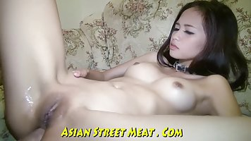 Adorable Asian brunette is wearing red shoes with high heels while getting fucked from the back