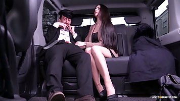 Perfect brunette, Lullu Gun is sucking her driver's huge cock, on the back seat of the car
