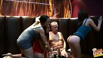 After some drinks, three drunken milfs are sucking their elderly man's massive dick, in the VIP room