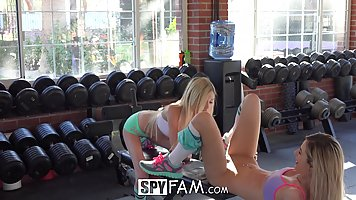 Two flexible teens are having lots of fun in the gym, while a horny guy is watching them