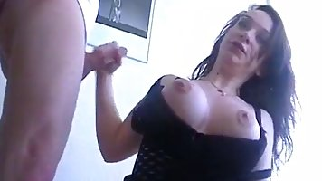 Slutty brunette in black, fishnet dress is sucking dick while getting fucked from the back