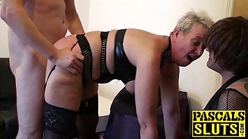 Blonde mature bitch with big tits is enjoying, while two horny men are fucking her