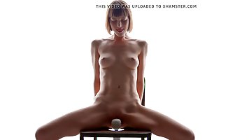Skinny teen, Stacy is sitting on the vibrating chair and enjoying every second of it