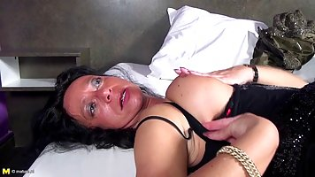 Mature woman with dark hair is using sex toys to keep herself satisfied, on a daily basis