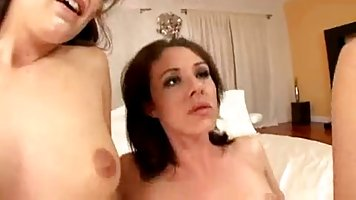 Two babes are sharing a huge cock, because there is enough of it for both of them