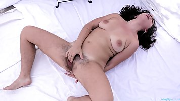 Charismatic babe with hairy pussy and armpits is masturbating like crazy in front of the camera