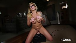 Big titted blonde with huge, black glasses is using a Sybian to satisfy her sexual needs