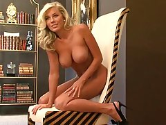 Great looking blonde, Katie Rivers likes posing for the camera and taking off her clothes completely