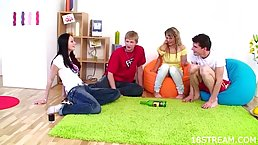 Two horny teens are playing a naughty game with two guys, and enjoying it a lot